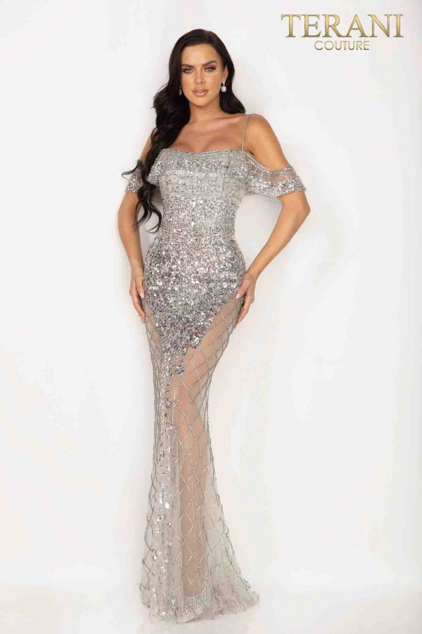 Iridescently beaded evening gown. Iridescently beaded, off the shoulder bodice extends down the center revealing strikingly sheer sides with window pane beading.
